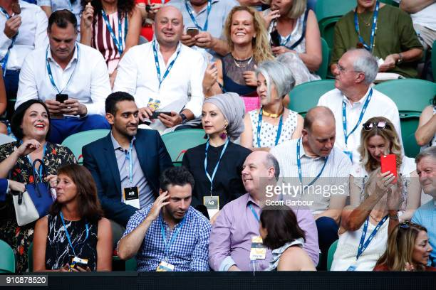 Television personality Waleed Aly and his wife Susan Carland watch the women's singles final between Caroline Wozniacki of Denmark and Simona Halep...