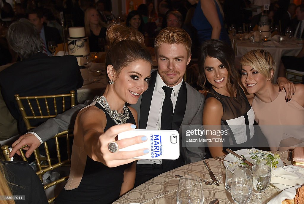 Television personality/actress Maria Menounos takes a selfie photo with actor/dancer Derek Hough, actress Nikki Reed and actress Julianne Hough at The Kaleidoscope Ball – Designing the Sweet Side of L.A. benefiting the UCLA Children's Discovery and Innovation Institute at Mattel Children's Hospital UCLA held at Beverly Hills Hotel on April 10, 2014 in Beverly Hills, California.