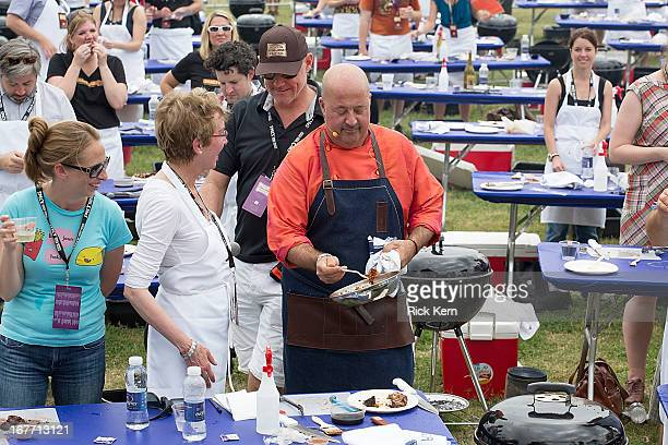 Television personality/chef Andrew Zimmern cohosts the 'Heads or Tails Handson Demo' during the second annual Austin FOOD WINE Festival at Butler...