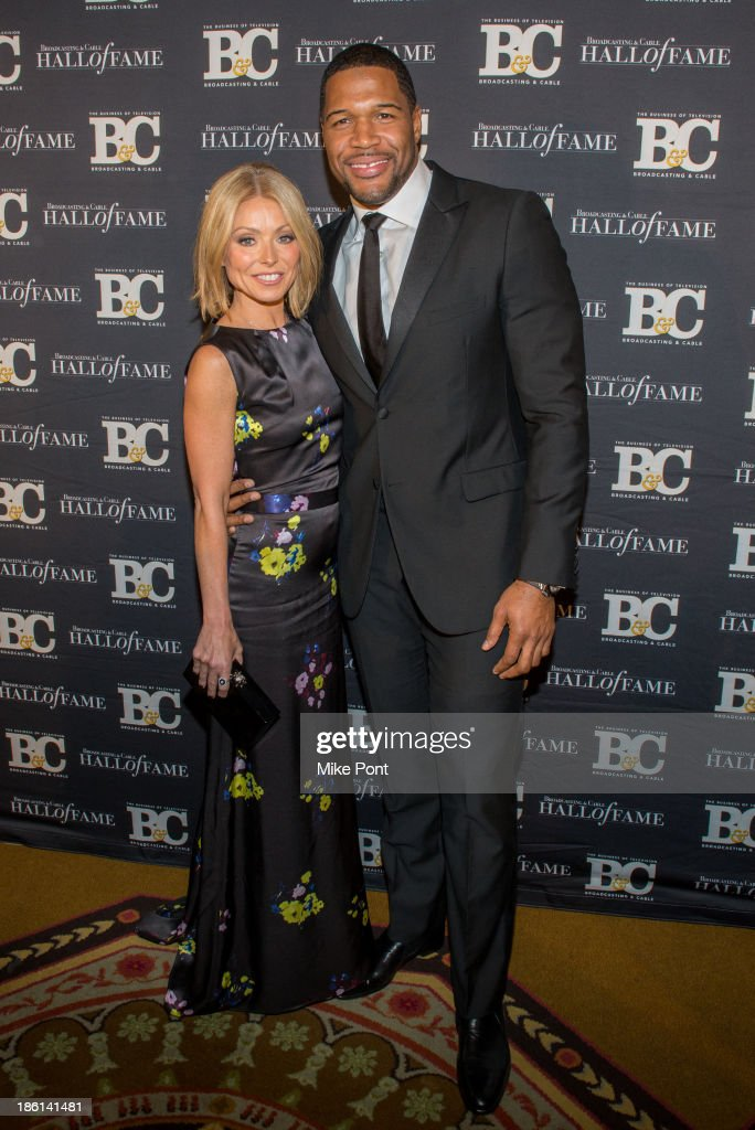 Television Personalitys Kelly Ripa and Michael Strahan attend the Broadcasting and Cable 23rd Annual Hall of Fame Awards Dinner at The Waldorf Astoria on October 28, 2013 in New York City.