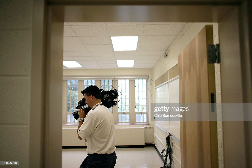 A television photographer moves thorugh one of classrooms on the second floor of Norris Hall ahead of the phased re-use of building June 14, 2007 in Blacksburg, Virginia. On April 16, 2007, Virginia Tech undergraduate student Hsung-wei Cho went on a shooting rampage, killing 30 of his 32 there, victims while they were attending or teaching engineering and language classes in Norris Hall. The floors and ceilings were all replaced and the walls repainted during the repair process. Virginia Tech President Charles Steger said the June 18 reopening of Norris Hall is the best way for the College of Engineering and the Department of Engineering Science and Mechanics to heal and move forward. No general assignment classes will be held in Norris, but the 70,000-square-foot building will be used for offices and laboratories. The classrooms where the shootings happened will remain closed.