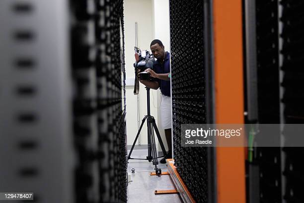 A television photojournalist documents the area where DNA samples are catalogued inside of the new Brooks Life Science Systems A3 SmaRTStore that was...