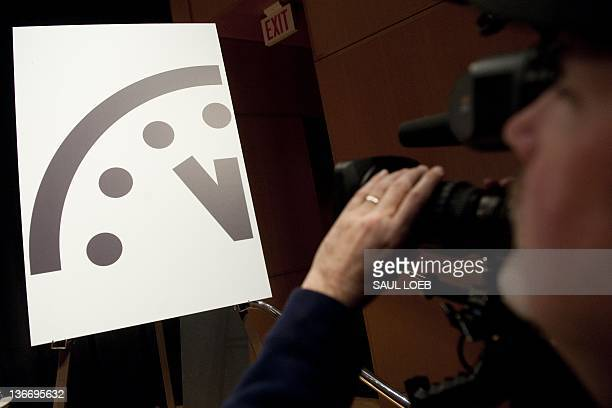 A television photojournalist records the Doomsday Clock following an announcement by the Bulletin of Atomic Scientists announcing that it has moved...
