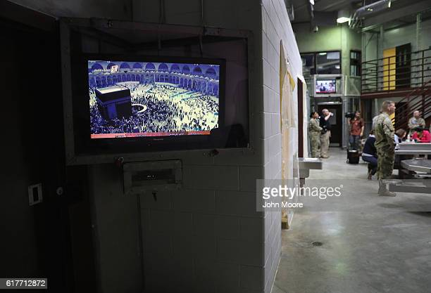 A television plays a program from Mecca Saudi Arabia as the military conducts a media tour of the Gitmo maximum security detention center on October...