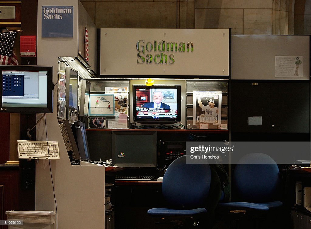 A television plays at the The Goldman Sachs booth on the floor of the New York Stock Exchange during afternoon trading December 16, 2008 in New York City. The Federal Reserve slashed the federal funds rate, the interest banks charge each other, to a record low of zero to one quarter percent, sending stocks higher in mid-afternoon trading. Goldman Sachs announced they posted their first loss since going public in 1999.