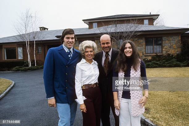 Portrait of sports media and television personality Joe Garagiola posing with his family during photo shoot in front of his home Scarsdale NY CREDIT...