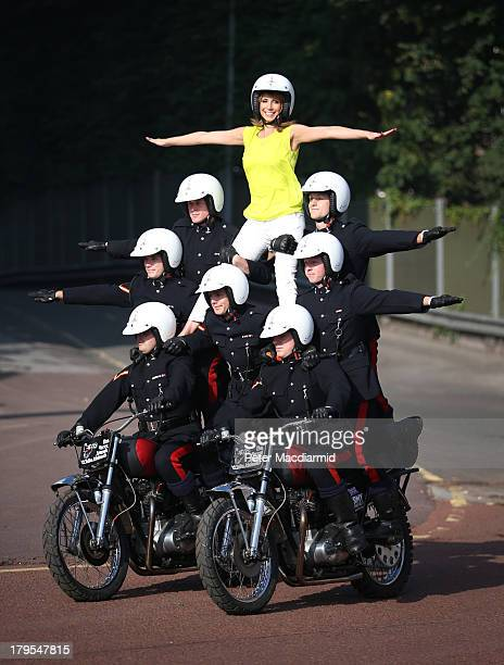 Television presenter Alex Jones performs with The Royal Signal's White Helmets display team during a photocall for The British Military Tournament at...