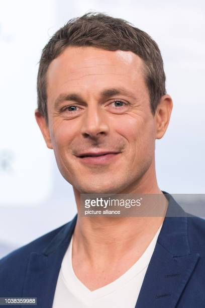 ARDtelevision presenter Alexander Bommes poses during a photocall prior to the press conference held by German public broadcasters ARDand ZDF on...