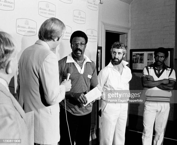 Television presenter and former England cricketer Tony Greig interviews the winning captain, Clive Lloyd of West Indies, during the presentation...