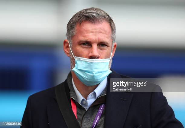 Television presenter and former footballer Jamie Carragher wearing a mask prior to the Premier League match between Everton FC and AFC Bournemouth at...