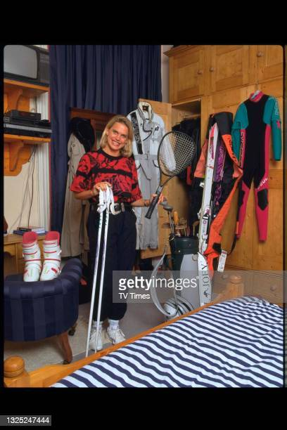 Television presenter Anna Walker photographed with some of her sports equipment at home, circa 1995.