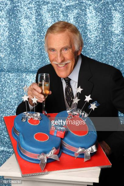 Television presenter Bruce Forsyth celebrates his 80th birthday with a glass of champagne and cake, on Februayr 4, 2008.