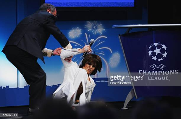 Television presenter Carole Rousseau faints during the UEFA Champions League Trophy handover and draw at The Hotel de Ville on March 10 2006 in Paris...