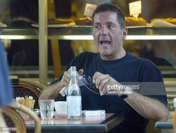 Television presenter Dale Winton is seen out having coffee with friends on May 18 2004 in Central London