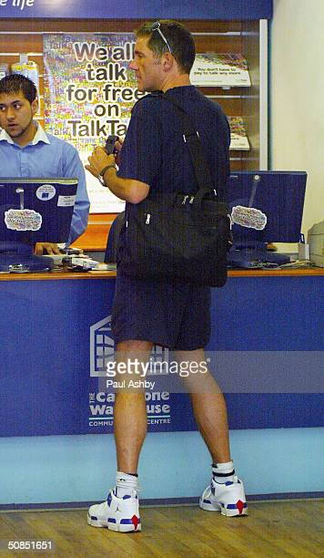 Television presenter Dale Winton is seen out with friends on May 18, 2004 in Central London.