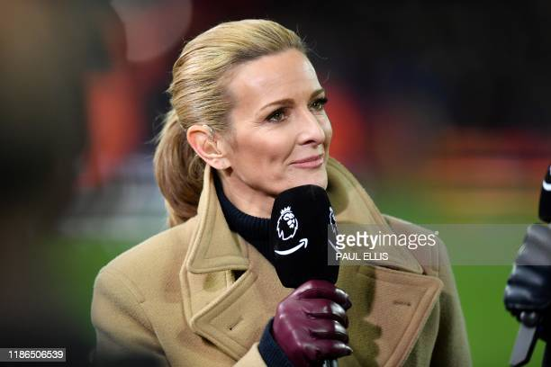 Television presenter Gabby Logan, working for Amazon Prime TV, works on the pitch ahead of the English Premier League football match between...