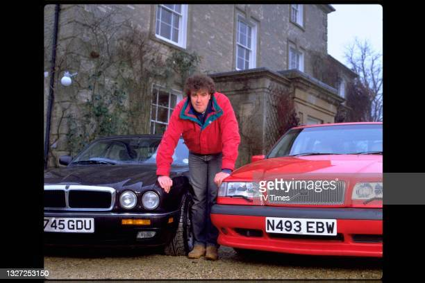 Television presenter Jeremy Clarkson, host of Jeremy Clarkson's Motorworld, photographed with his cars at home, circa January 1995.