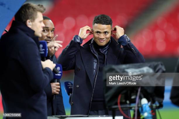 television presenter Jermaine Jenas adjusts his headphones during the Group B match of the UEFA Champions League between Tottenham Hotspur and FC...