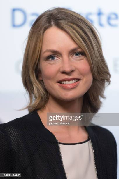 Television presenter Jessy Wellmer poses during a photocall prior to the press conference held by German public broadcasters ARDand ZDF on their...