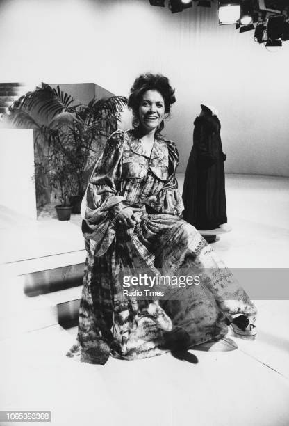 Television presenter Joan Bakewell wearing an extravagant costume on the set of the television series 'For the Sake of Appearance' January 5th 1973