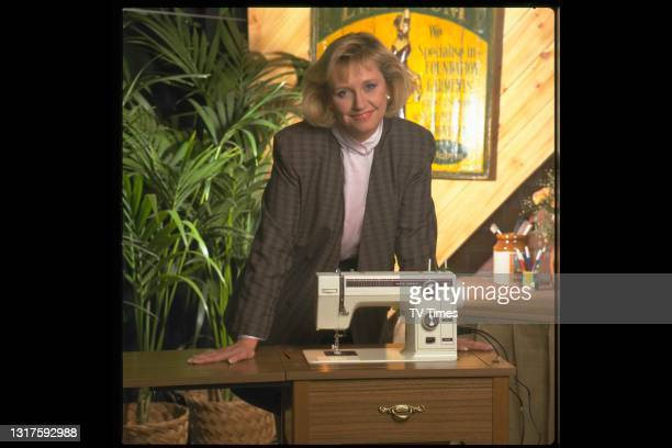 Television presenter Judy Finnigan photographed with a sewing machine, circa 1989.