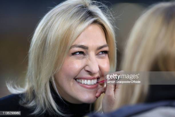 Television presenter Kelly Cates smiles as she has lipstick applied before the Premier League match between Wolverhampton Wanderers and Manchester...