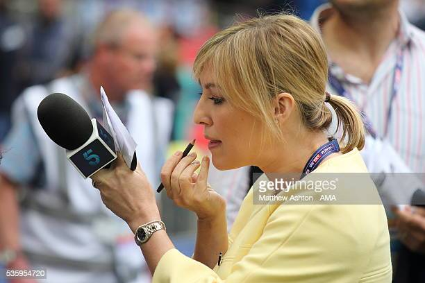 Television presenter Kelly Cates the daughter of football legend Kenny Dalglish applies make up whilst holding a Channel 5 microphone during the Sky...