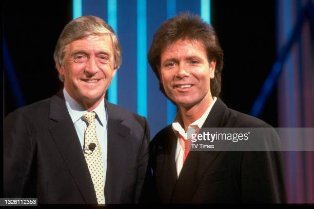 Television presenter Michael Parkinson and pop singer Cliff Richard on the set of chat show Parkinson One To One, circa June 1988.