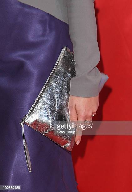 Television presenter Nadine Krueger carries a handbag as she attends the 'Ein Herz Fuer Kinder' charity gala at Axel Springer Haus on December 18...