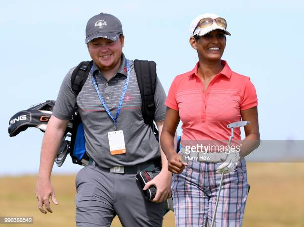 Television presenter Naga Munchetty smiles after a birdie on the ninth green during the ProAm event of the Aberdeen Standard Investments Scottish...