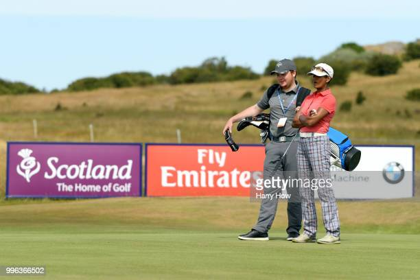 Television presenter Naga Munchetty waits with her caddie on the ninth green during the ProAm event of the Aberdeen Standard Investments Scottish...
