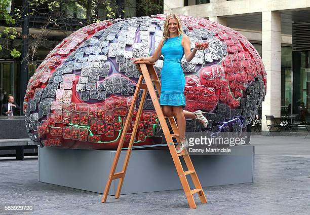 Television presenter Rachel Riley places the final homegrown strawberries on top of a giantmodel brain on July 28 2016 in London United Kingdom