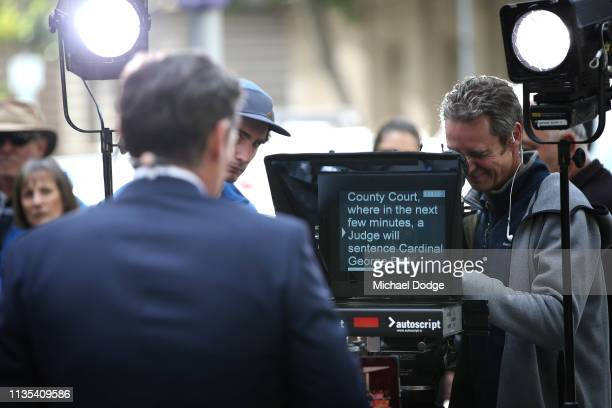 Television presenter reads an autocue at Melbourne County Court on March 13, 2019 in Melbourne, Australia. Cardinal George Pell was remanded in...