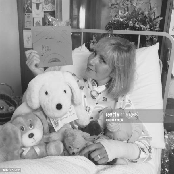 Television presenter Sarah Greene pictured in a hospital bed with her legs in plaster following a helicopter crash photographed for Radio Times in...