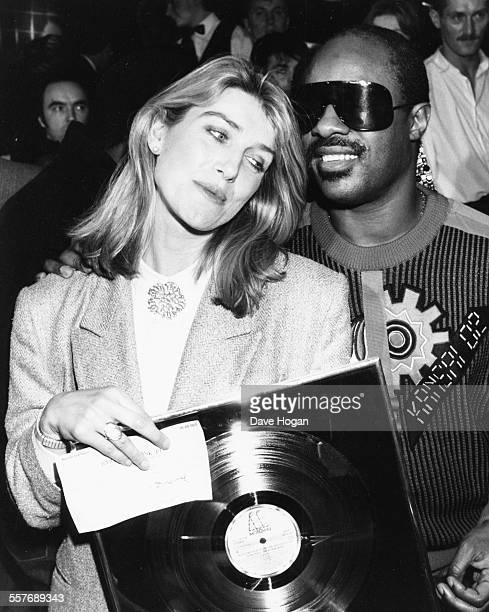 Television presenter Selina Scott and musician Stevie Wonder at a charity party where he donated a £1000 check to a children's charity London...