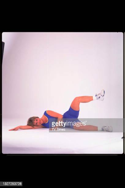 Television presenter Susan Kane, known for her role as a fitness guru on Good Morning Summer, photographed exercising, circa 1995.