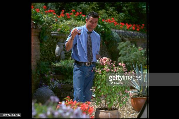 Television presenter William Van Hage, known for co-hosting home improvement series Instant Gardens,photographed in his own garden at home, circa...