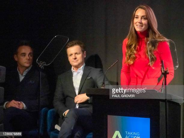 Television presenters Ant McPartlin and Declan Donnelly listen as Britain's Catherine, Duchess of Cambridge delievers a keynote speech during the...