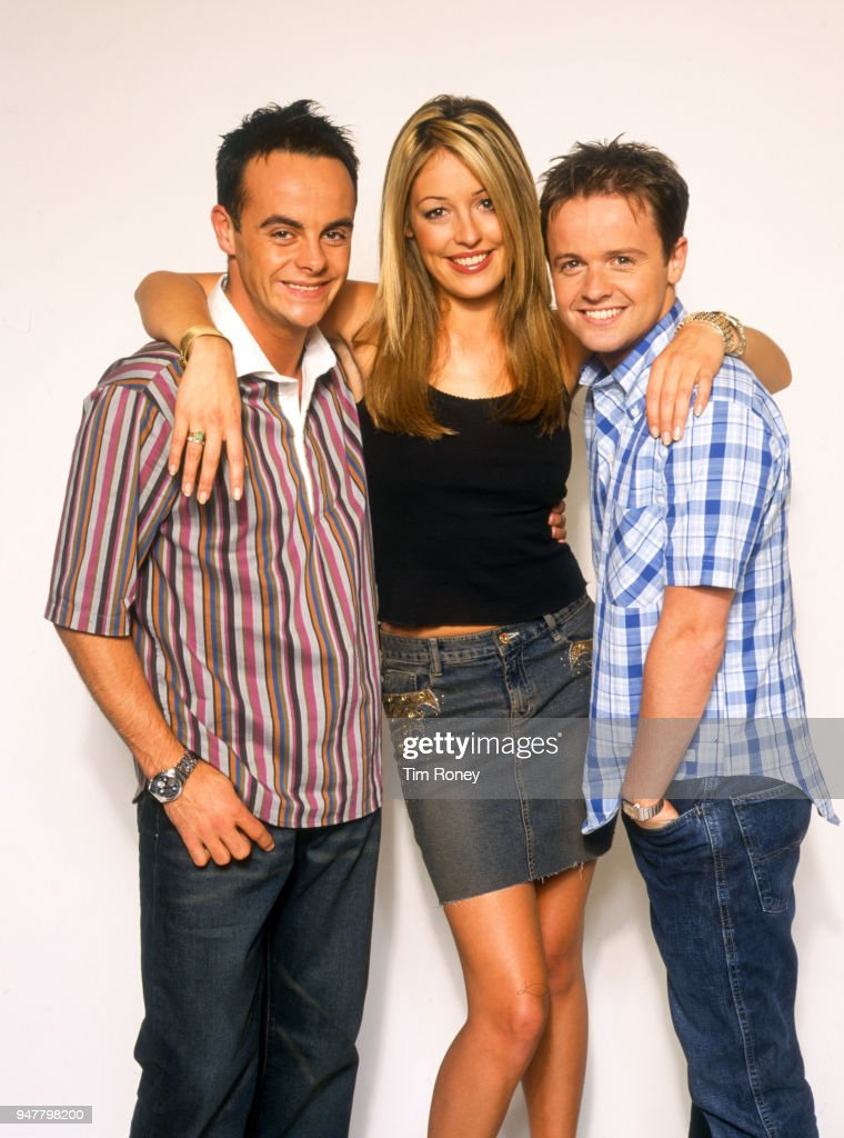 Television presenters Anthony McPartlin, Cat Deeley and Declan Donnelly, co-hosts of Saturday morning television series, 'SMT Live', circa 2000.