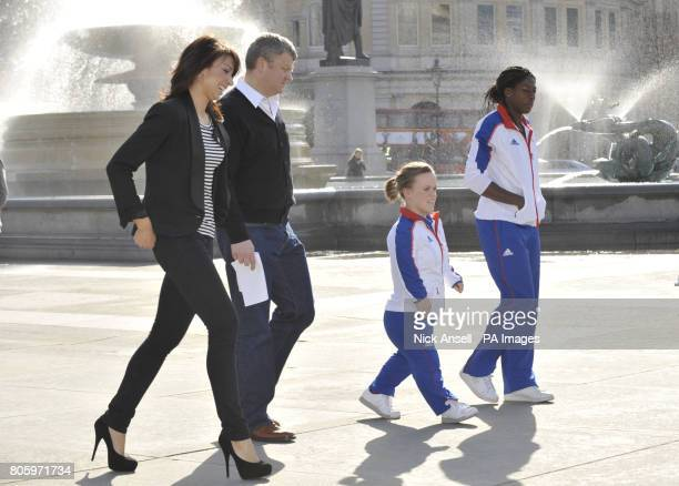 Television presenters Christine Bleakley and Adrian Chiles walk with Paralympian double gold medallist Ellie Simmonds and Olympic gold Christine...
