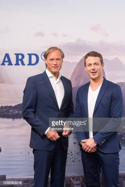 ARDtelevision presenters Gerhard Delling and Alexander Bommes pose during a photocall prior to the press conference held by German public...