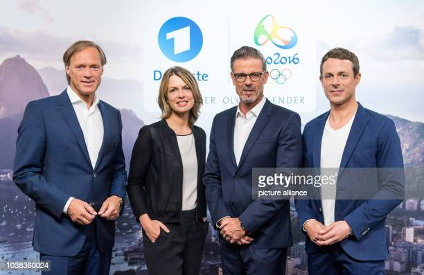 ARDtelevision presenters Gerhard Delling Jessy Wellmer Michael Antwerpes and Alexander Bommes pose during a photocall prior to the press conference...