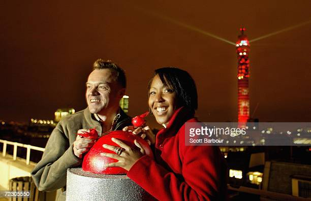 Television presenters Graham Norton and Angellica Bell push a button to turn on the BT Tower's Red Nose lights at the official launch of the UK Comic...
