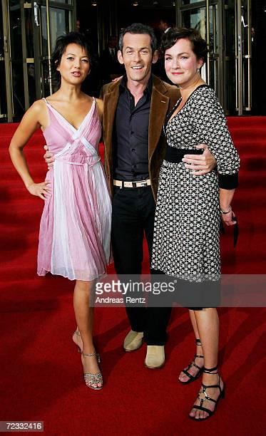 "Television presenters Madeleine Wehle, Harald Pignatelli und Angela Fritsch arrive at the ""Goldene Henne"" awards at the Friedrichstadtpalast on..."