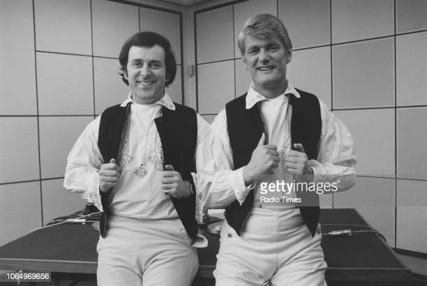 Television presenters Terry Wogan and Pete Murray wearing matching outfits photographed for Radio Times in connection with the Eurovision Song...