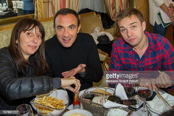 Television producer Anne Marcassus Television show host Nikos Aliagas and Marcassus' assistant JeanPhilippe have a lunch break during the shooting of...