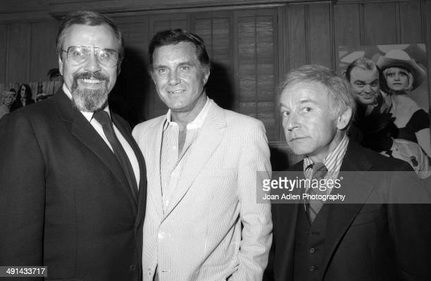 Television producer George Schlatter with actor Cliff Robertson and actor Henry Gibson at Rowan Martin's Laugh In cast reunion in 1983 in Los Angeles...