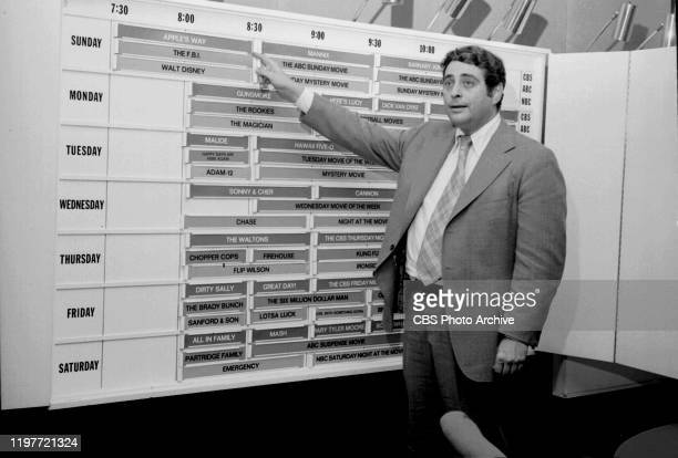 CBS television programming vice president Fred Silverman standing at a television program scheduling board November 28 1973 New York NY