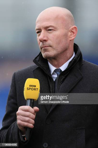 Television pundit Alan Shearer holds the microphone during the FA Cup Fourth Round match between Shrewsbury Town and Liverpool FC at New Meadow on...