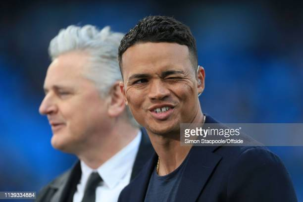 Television pundit Jermaine Jenas and presenter Des Kelly look on during the UEFA Champions League Quarter Final second leg match between Manchester...